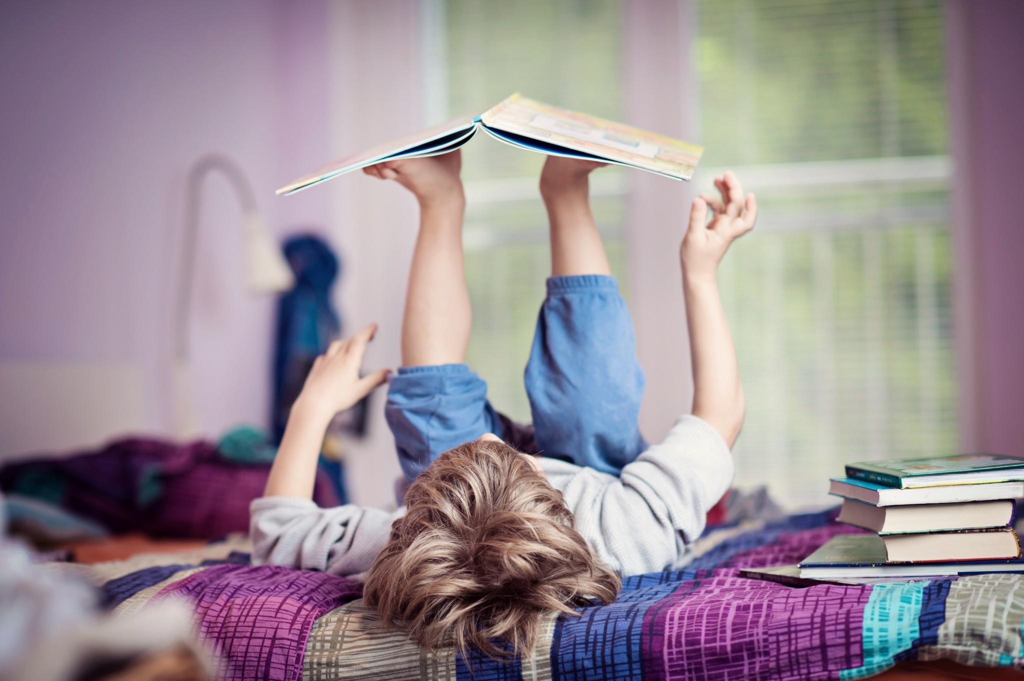 Boy reading Children's Books, Education Closet