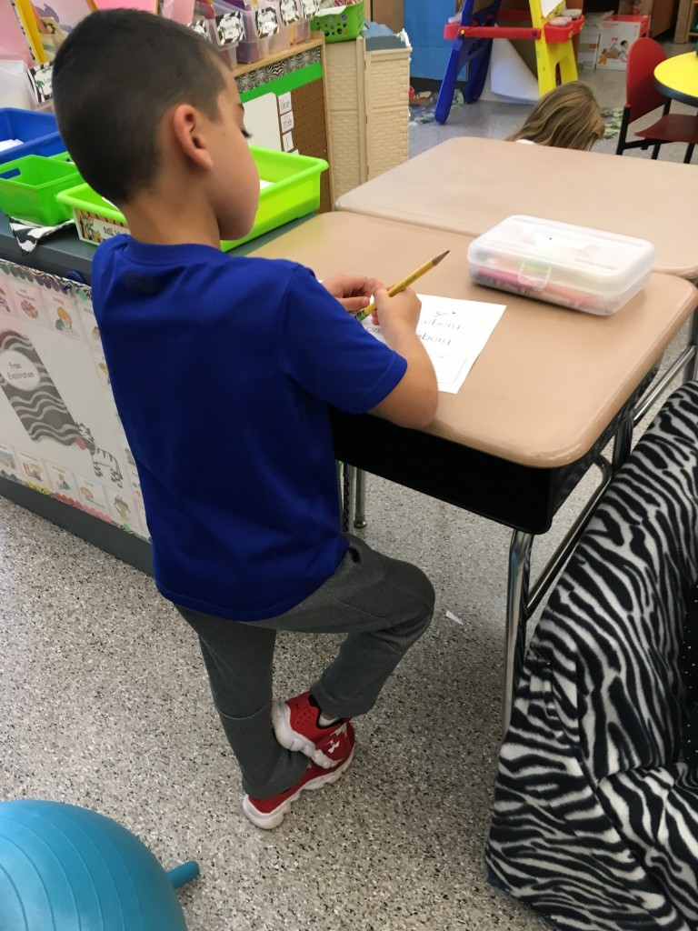 Student standing at his desk for flexible seating